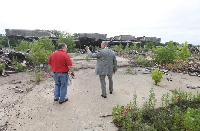 Zanesville Mayor Don Mason, right, tours the former Lear property with State Senator Tim Schaffer on Wednesday. Shaffer helped usher brownfield remediation money through the state senate, which Mason hopes can be used to help clean up the Linden Avenue site.