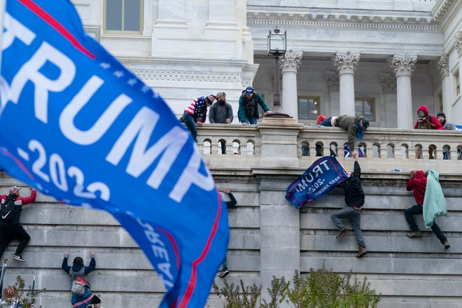 Supporters of then-President Donald Trump try to break through a police barrier at the Capitol in Washington, D.C., on Jan. 6, 2021.