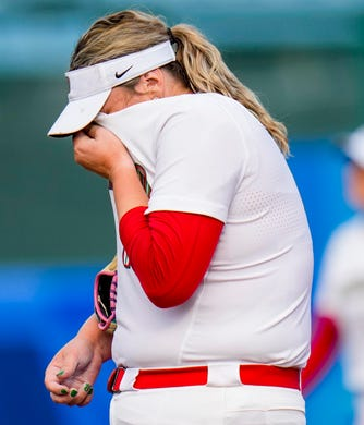 Mexico's pitcher Dalla Escobedo wipes the sweat from her face on Wednesday, July 21, 2021, during a matchup between Mexico and Canada at the Tokyo 2020 Olympic Summer Games held at Fukushima Azuma Stadium in Fukushima, Japan.