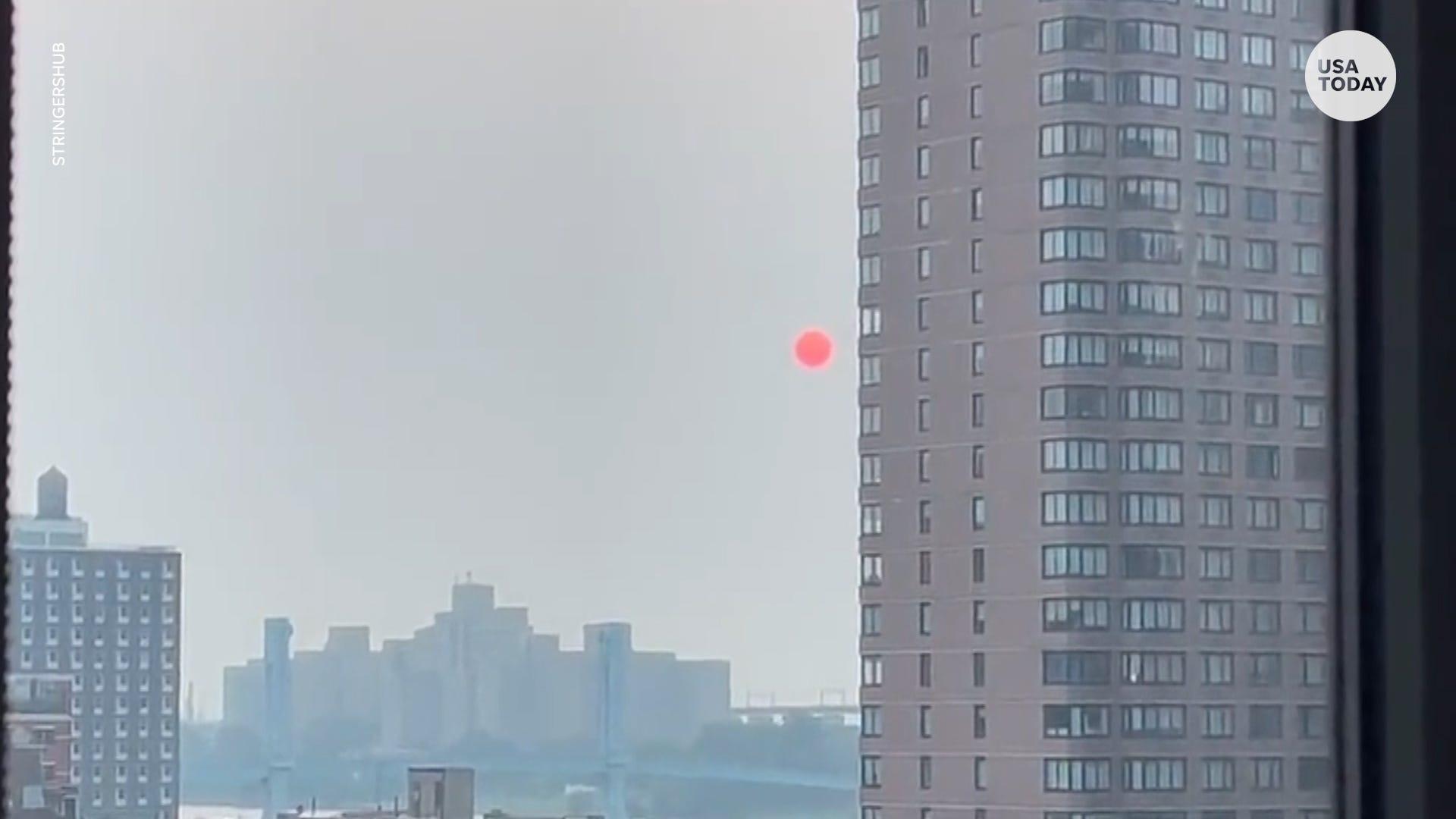 Western wildfires create fiery New York sunrise