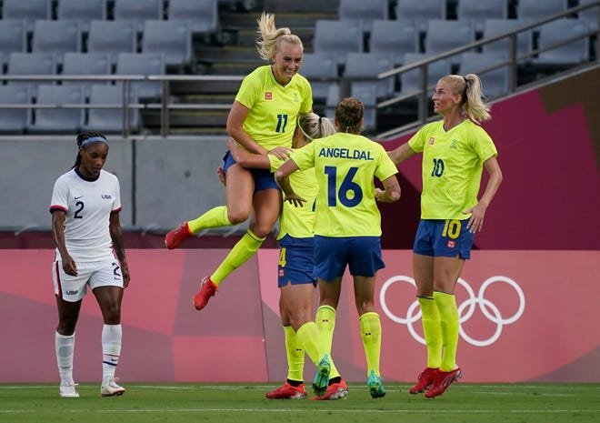 Sweden forward Stina Blackstenius (11) celebrates with teammates after scoring a goal against the U.S. team during the first half at the Tokyo 2020 Olympic Summer Games at Tokyo Stadium.