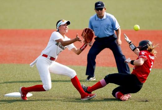 Canada outfielder Erika Polidori (3) slides past Mexico infielder Anissa Urtez (17) during the Tokyo 2020 Olympic Summer Games held at Fukushima Azuma Stadium in Fukushima, Japan.