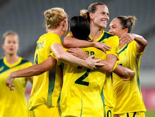 Australia's Sam Kerr (2) celebrates with her teammates after scoring her side's 2nd goal during a women's soccer match against New Zealand at the 2020 Summer Olympics, Wednesday, July 21, 2021, in Tokyo. (AP Photo/Ricardo Mazalan) ORG XMIT: OLYFV168