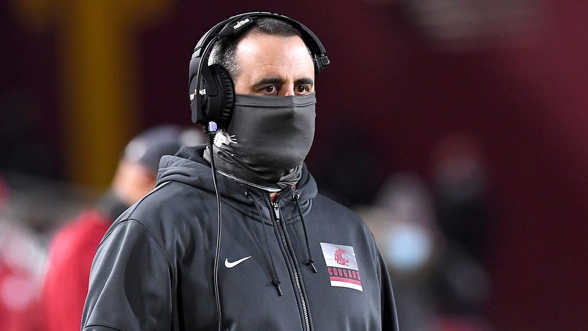 Unvaccinated Washington State football coach Nick Rolovich will not attend Pac-12 media day