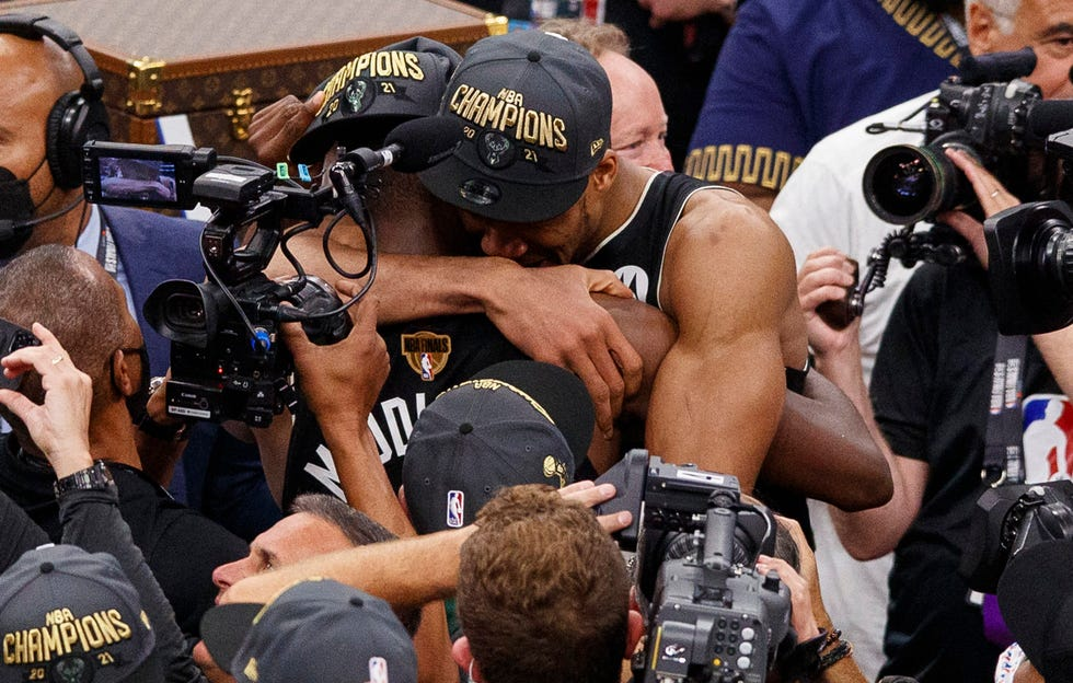 Giannis Antetokounmpo shares a hug with Khris Middleton after the Bucks won the NBA title.