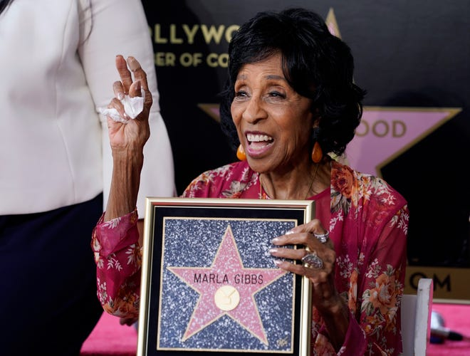 Actress Marla Gibbs celebrates with a replicator's of her new star on the Hollywood Walk of Fame following a ceremony for her, Tuesday, July 20, 2021, in Los Angeles.