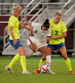 Christen Press (center), along with fellow U.S. Women's National Team star Tobin Heath, was selected by Racing Louisville FC in the Nov. 2020 NWSL expansion draft.