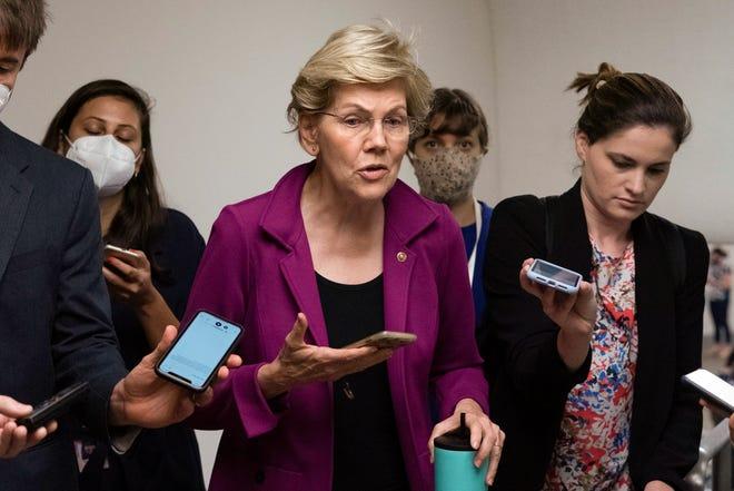 U.S. Sen. Elizabeth Warren, D-Mass., talks to reporters as she walks to the Senate chamber on Capitol Hill, in Washington, Wednesday, July 21, 2021.