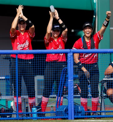 Canadian softball players celebrate a run against Mexico  during the Tokyo 2020 Olympic Summer Games held at Fukushima Azuma Stadium in Fukushima, Japan.