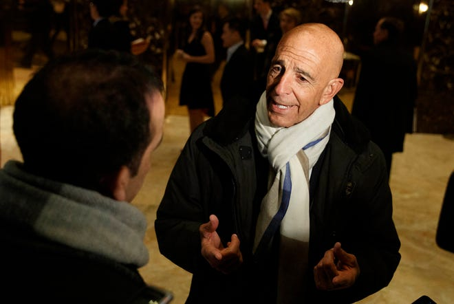 FILE - This photo from Tuesday Jan. 10, 2017, shows Tom Barrack peaking with reporters in the lobby of Trump Tower in New York before meeting with President-elect Donald Trump. Barrack, chair of former President Donald Trump's 2017 inaugural committee, was arrested Tuesday, July 20, 2021, in California on charges alleging that he and others conspired to influence Trump's foreign policy positions to benefit the United Arab Emirates. (AP Photo/Evan Vucci, File) ORG XMIT: BMNY101