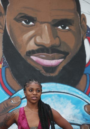 Chardae Slater talks in July about LeBron James and her mural in Akron.