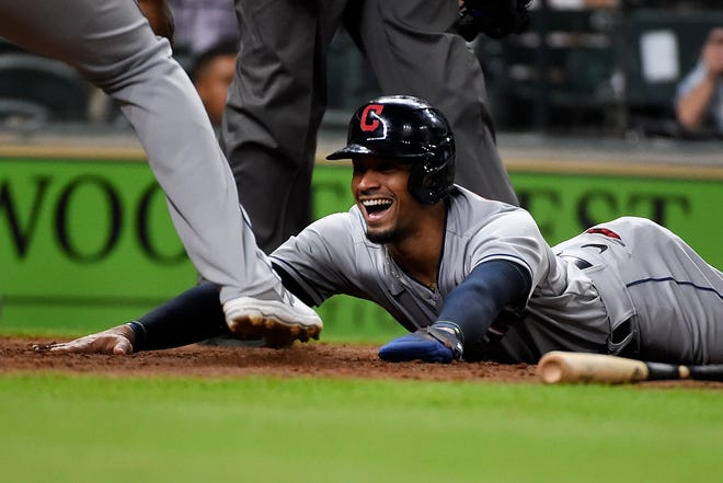 Cleveland's Oscar Mercado smiles after scoring on Ernie Clement's three-run double during the sixth inning of a baseball game, Wednesday, July 21, 2021, in Houston. (AP Photo/Eric Christian Smith)
