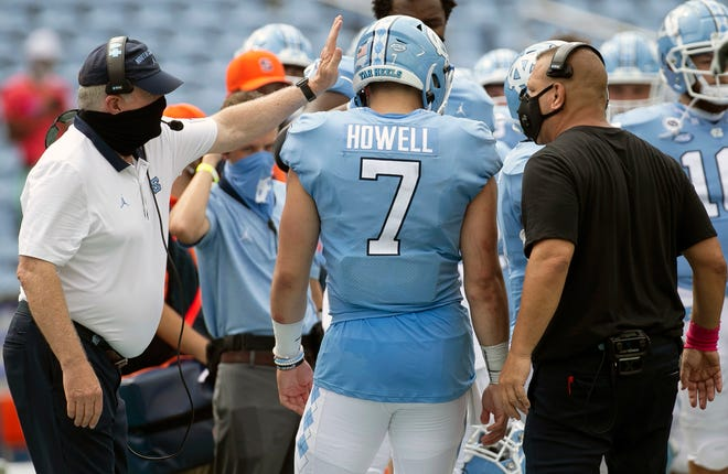 North Carolina head coach Mack Brown, left, and offensive coordinator Phil Longo congratulate quarterback Sam Howell after a touchdown in last year's win over Syracuse. Howell's 68 career touchdowns already are tied for the most in school history, and some believe he could go No. 1 overall in next year's draft.