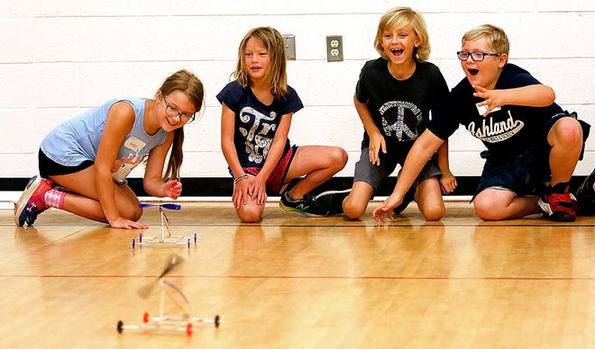 Tenley Slone, Kiersten Harris, Emerson Bull and Liam Slone race their propeller cars after building them during Mr. Lee's Incredible Stuff Camp Thursday, July 22, 2021 at Ashland Christian School. TOM E. PUSKAR/TIMES-GAZETTE.COM