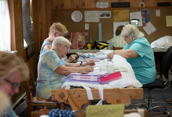 Quilters at First United Methodist Church in Ellwood City work together on several quilts at a time. The group of women gets together every Tuesday for several hours to make quilts for several charities.