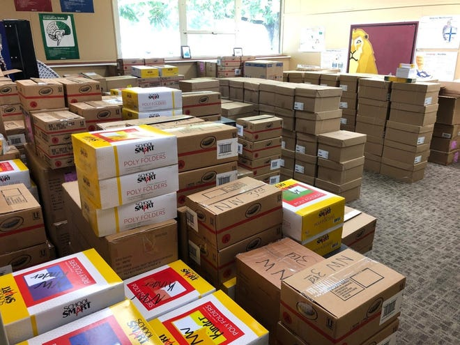 Boxes stacked upon boxes line the walls of a hallway, packing an entire room from wall to wall at the Brownwood ISD Central Support Center.