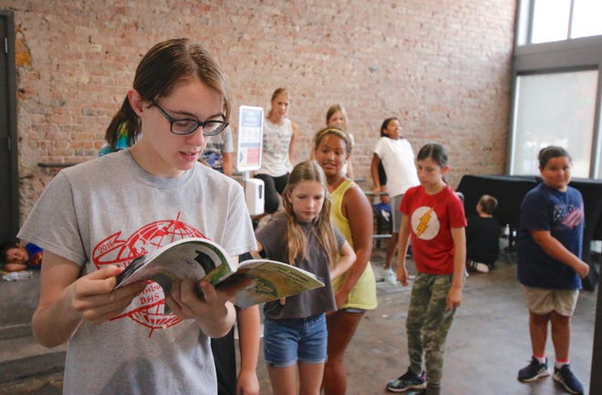 """James Williams, a Lyric Theatre intern and a choreographer for the Summer  Workshop production of  """"The Jungle Book,"""" looks over material Wednesday in the theatre's Robert and Florence Moore Studio. Cast members including (from left) Hadley Hager, Mollie Miles, Rebecca Evetts and Addie Flores await instructions. Reagan Fraze is director of """"The Jungle Book Jr.,"""" which has cast members in grades 3 through 6 and will be performed Aug. 6, 7 and 8. Also as part of the Summer Workshop, an older cast will perform """"Beauty and the Beast Jr."""" July 30-Aug. 1."""