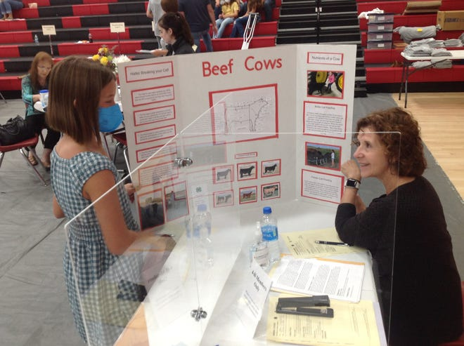 Conference judging is an important part of 4-H General Show, where the judges share expertise with the 4-H members. Kate Fitzjarrald discussed her Animal Science project with judge Velynna Spangler.