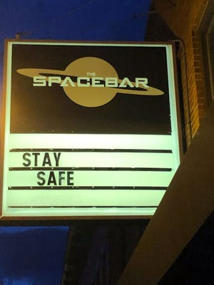 The sign outside of Spacebar on High Street