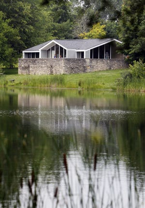 The rear of the newly renovated Alum Creek State Park office is shown across a pond west of Alum Creek Lake.
