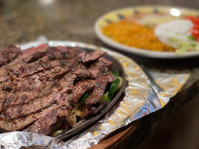 Cadillac fajitas at Azteca Mexican Grill include slices of charbroiled skirt steak cooked with a special seasoning, served in a sizzling skillet with mushrooms, poblano peppers and onions.