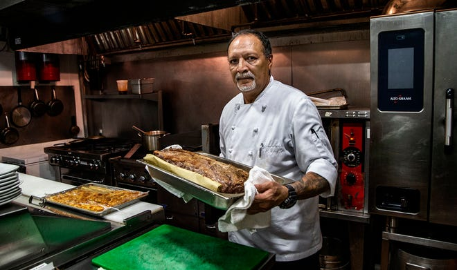 Cook Noraldo Saavedra works in the kitchen of the MKT Kitchen restaurant in Coral Gables, Florida, where he works after deciding not to come back to his previous job at the Fontainebleau hotel in Miami Beach. 500,000 US hotel jobs won't return this year, an industry association says.