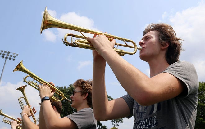 Grandview Heights High School sophomore Steve Chordas and the rest of the band take to the field at the school July 21 to practice for the fall season.