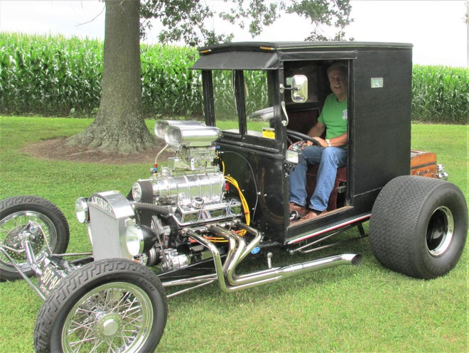 Wayne County's Wes Mellott displays his homemade hot rod, built from a converted Amish buggy and pieces and parts he's collected from swap meets. Mellott has built several custom cars over the years in his garage.
