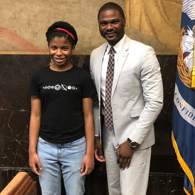 Zaila Avant-garde, the 2021 Scripps National Spelling Bee Champion, poses for a photo with state Rep. Ken Brass.