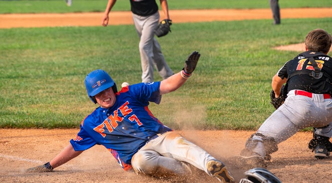 Blue Springs Post 499 Fike runner Jacob Rehkow (7) beats the throw home in an American Legion Zone 2 Tournament first-round game against the Harrison County Hot Rods Wednesday at Hidden Valley Park. Fike rallied from a 6-0 deficit to claim a 14-6 win.