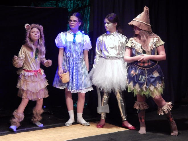 """Old Fort Players actors perform """"The Wizard of Oz"""" this weekend, Friday through Sunday, at the Performing Arts Theater in Fort Madison. From left are Sunshine Zioui as Cowardly Lion, Aida Troutman as Dorothy, McKensie Daly as Tin Woodman and Sofia Gilbert as Scarecrow. The OFP Youth Summer Theater Program will also perform """"The Rehearsal"""" with a brief intermission after """"The Wizard of Oz."""""""