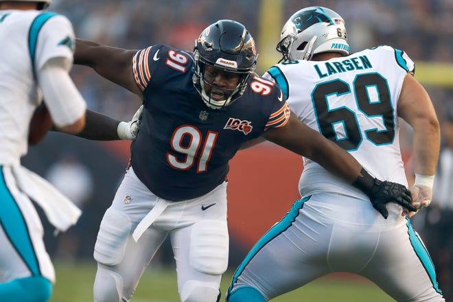 Chicago Bears nose tackle Eddie Goldman breaks through the Carolina Panthers offensive line during the first half of a preseason game Thursday, Aug. 8, 2019, in Chicago.