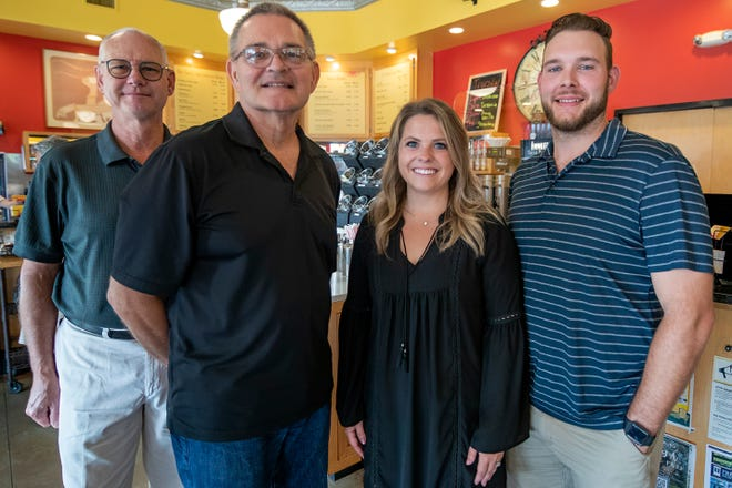 Innkeeper's Fresh Roasted Coffee current owners Mike Bond, left, and Johan Ewalt, second from left, pose for a photo with new owners Jessica and Ben Ketchum on Thursday.