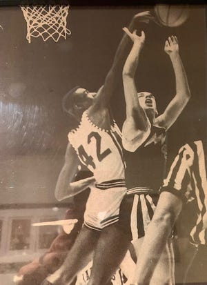 Barry Swanson has a shot blocked by Belleville's Joe Wiley in a 1965-66 state semifinal game. Galesburg survived a miss by Wiley in the lane at the buzzer to win 65-64 and advance to the state championship game. Wiley scored 27 points or more in Belleville's final four games.