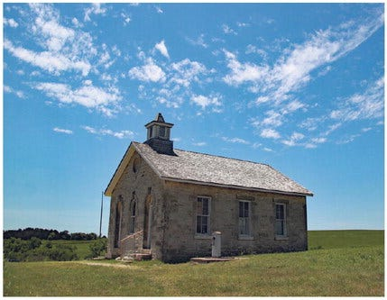 Little Schoolhouse on the Prairie: The limestone Lower Fox School, built in 1884, sits atop a hill on the prairie and provides a brief break from the heat and sun.
