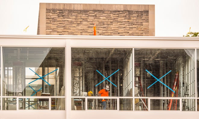 Construction crews work on the Mies Building for the Eskenazi School of Art, Architecture & Design on the Indiana University campus on Thursday, July 22, 2021.
