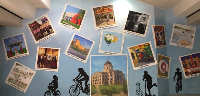 Local artists have created a 60- by 15-foot mural this summer depicting Bloomington scenes on an inside wall of the College Mall where the entrance to Macy'sused to be. Speaking during an online Bloomington Rotary meeting, Adam Nahas, executive director of Artisan Alley, said the display was completed July 19.