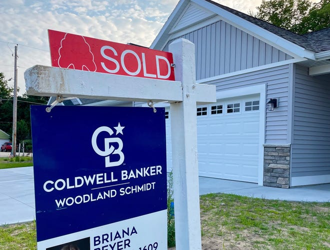 """A """"sold"""" sign outside a property listed by Briana Beyer of Coldwell Banker Woodland Schmidt. The average home price has risen to $265,000."""