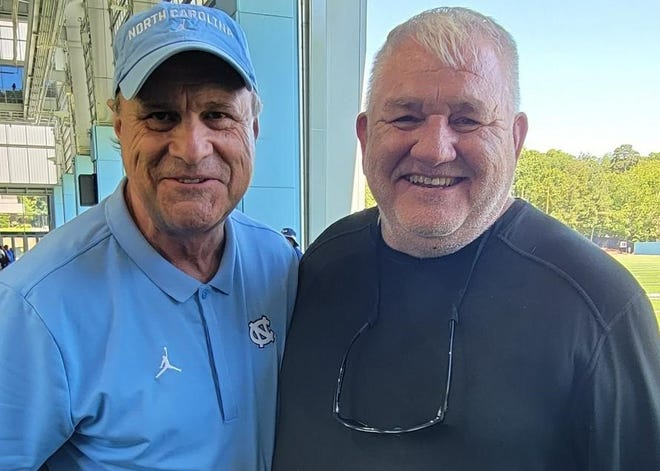 Hendersonville High football coach Jim Sosebee poses with his former college coach, Sparky Woods, who is now the senior advisor at UNC, at a 7-on-7 tournament held over the summer at Chapel Hill.