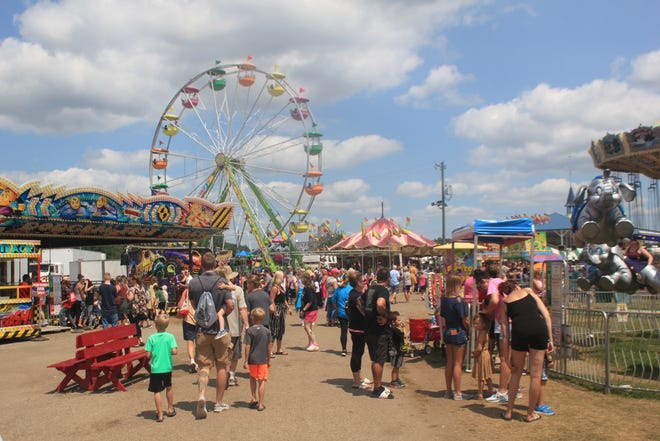 The 2021 Ionia Free Fair drew large crowds, but reports of a potential COVID outbreak have called to question the risks associated with similar summer events.