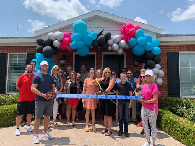 4D Moments, LLC, 2032 82nd Street, #103 Lubbock. Holding scissors is owner/president Christin Carlson. Holding ribbon are Chamber Ambassadors Cutter Sparks, left, and Kauli Sparks. Others pictured are staff, family, friends and other Lubbock Chamber Ambassadors.