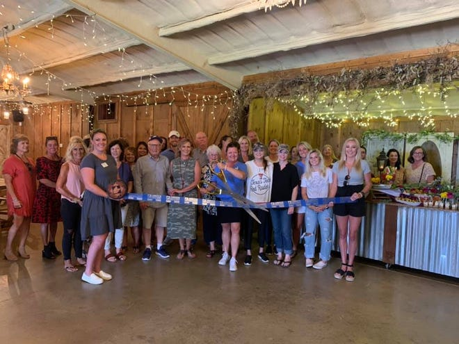 Homemade Goodness by Jada , 6323 FM 1294 Lubbock (At'l Do Farms Corn Maize). Holding scissors is owner Jada Morrow. Holding ribbon are Chamber Ambassadors Katie Schafer, left, and Amy Stephens. Others pictured are staff, family, friends, Lubbock Chamber Ambassadors Past Chairwoman Kim Putman and other Lubbock Chamber Ambassadors.
