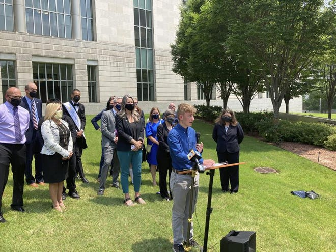 Dylan Brandt speaks at a news conference outside the federal courthouse in Little Rock, Arkansas, on Wednesday, July 21, 2021. Brandt, 15, has been receiving hormone treatments and is among several transgender youth who challenged a state law banning gender confirming care for trans minors. A federal judge on Wednesday blocked that law's enforcement.