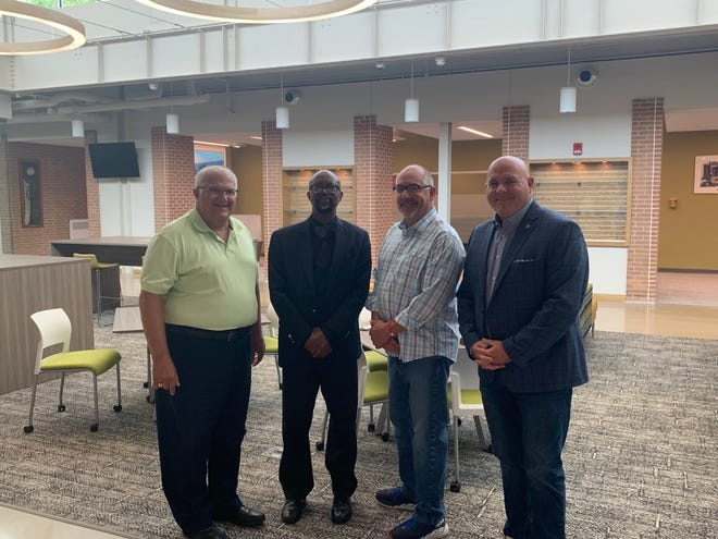 Sen. Dale Zorn (from left), Dr. Kojo Quartey, Rep. Joe Bellino and Rep. T.C. Clements at MCCC.