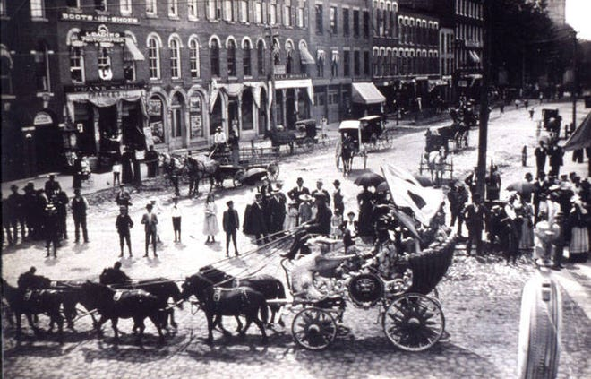 This photo shows Monroe at the corner of Washington and Front Streets, circa 1900. The B. Dansard and Sons Bank is clearly visible. Monroe's O.L. Club met upstairs. F.S. Sill Boots & Shoes also appears.