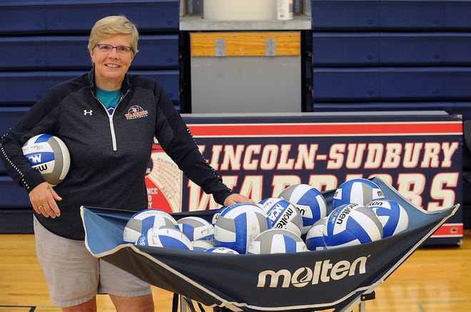 Judy Katalina, retired Lincoln-Sudbury Regional High School volleyball coach and administrative assistant, in the school gymnasium on July 22, 2021.