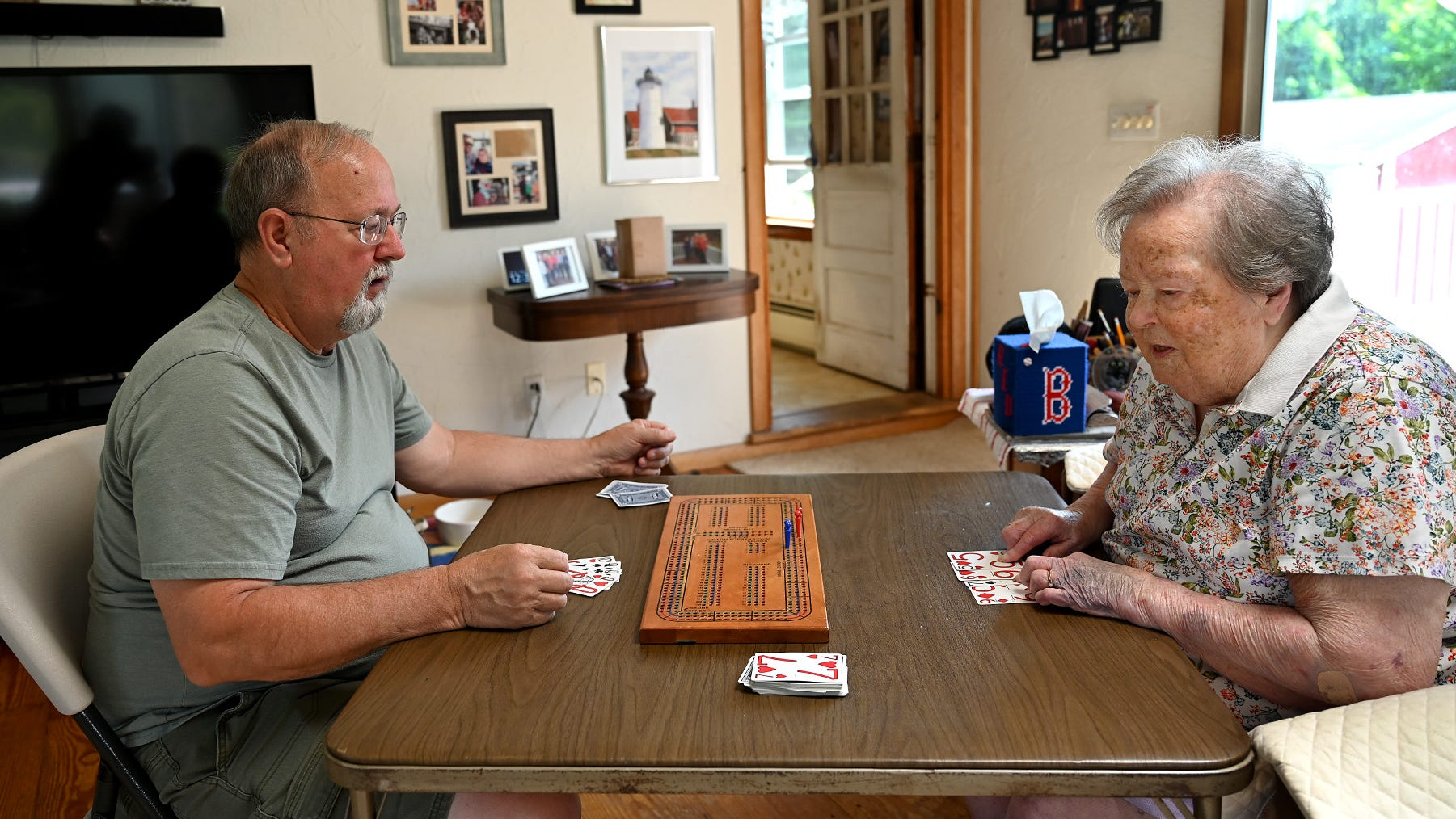 A Navy veteran, a wife and mother, a cribbage player, and more. Jini Henderson turns 100.