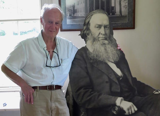 Norman K. Dann, Ph.D poses with the Gerrit Smith exhibit on the Gerrit Smith Estate National Historic Landmark in Peterboro. Dann will be presenting a series of eight programs on the Gerrit and Ann Smith family of Peterboro and the crusade for human rights from 4 to 6 p.m. Wednesdays beginning Aug. 4.