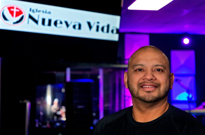 Pator Joel Ojeda of Iglesia Nueva Vida stands in his church in Oklahoma City on Thursday, July 22. Ojeda is branching out and offering an English speaking service in addition to his standard Spanish speaking services.