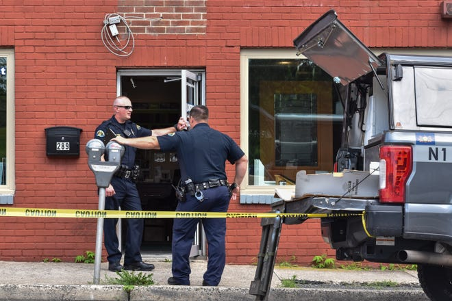 Stroudsburg Area Regional Police officers stand outside a crime scene in East Stroudsburg on Thursday, July 22, 2021. A woman's body was found in a dumpster in a lot next to the Salvation Army on Washington Street.